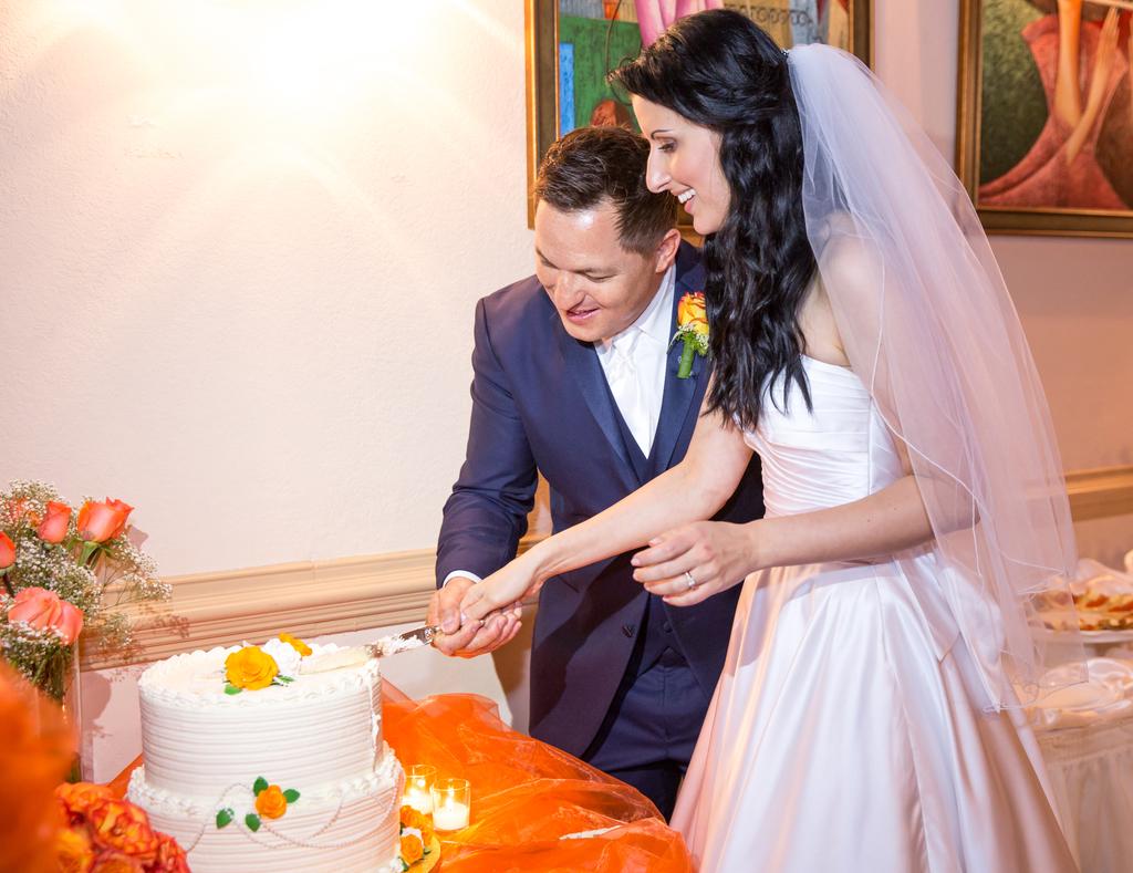 Michel Szabo and Anna Szabo Cutting Their Wedding Cake